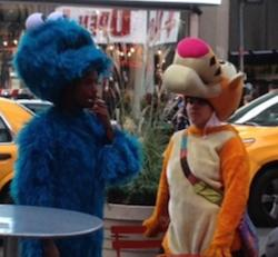 Cookie Monster and Tigger enjoy a smoke break in the middle of Times Square