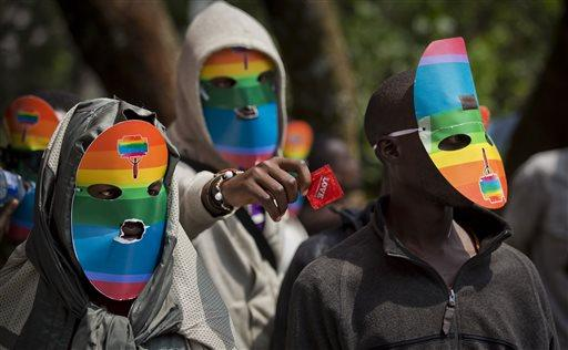 Kenyan gays, lesbians and supporters wear masks to preserve their anonymity, as they stage a rare protest, against Uganda's increasingly tough stance against homosexuality.