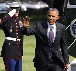 President Barack Obama waves after stepping off Marine One helicopter on the South Lawn of the White House in Washington,
