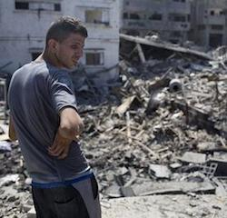 A Palestinian inspects a destroyed house in the heavily bombed Gaza City neighborhood of Shijaiyah, close to the Israeli border, Friday, Aug. 1, 2014.