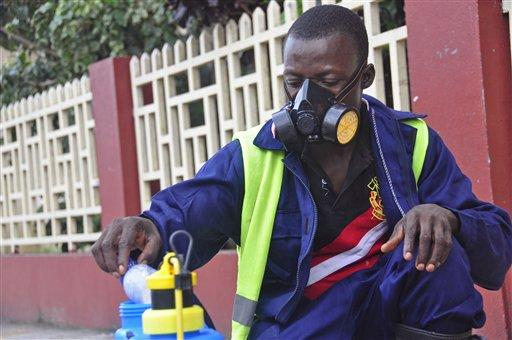 An employee of the Monrovia City Corporation mixes disinfectant before spraying it on the streets in a bid to prevent the spread of the deadly Ebola virus.