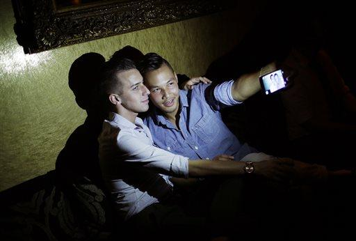 Philip Noynosoudachanh, right, takes a selfie with Josh Smith at Liaison Nightclub in Bally's Las Vegas.