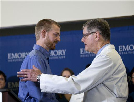 Ebola victim Dr. Kent Brantly, left, embraces Dr. Bruce Ribner, medical director of Emory's Infectious Disease Unit.