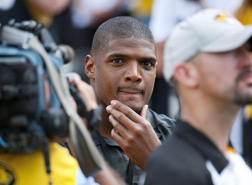 Former Missouri player Michael Sam watches pregame festivities before the start of the South Dakota State-Missouri NCAA college football game Saturday, Aug. 30, 2014, in Columbia, Mo