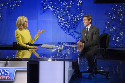"In this Wed., Aug. 27, 2014 photo provided by ABC, Diane Sawyer, left, signs off on her last broadcast as anchor of ""World News,"" with new anchor, David Muir, right, looking on in New York"