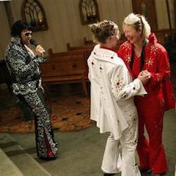 In this July 19, 2014 file photo, Sari Van Poelje, in red, dances with Katharina during their commitment ceremony given by Elvis tribute artist Michael Conti, left, at the Viva Las Vegas Wedding Chapel in Las Vegas. Gay marriage isn't legal in Nevada but the Viva Las Vegas Wedding Chapel will perform a commitment ceremony for couples of any sex. T
