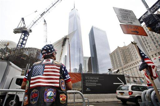 Jose Colon, of New York, looks up at 1 World Trade Center.
