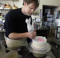In this March 10, 2014 file photo, Masterpiece Cakeshop owner Jack Phillips decorates a cake inside his store, in Lakewood, Colo. Colorado's Civil Rights Commission upheld a judge's ruling that Phillips cannot refuse to make wedding cakes for same-sex couples, despite Phillips' cited religious opposition to same sex marriage. The panel says doing so violates state laws prohibiting businesses from discriminating against gay people.