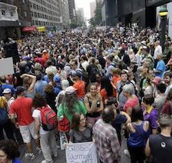People fill 58th Street between 8th and 9th Avenue in New York before a climate change protest march Sunday, Sept. 21, 2014. Thousands of people from across the nation are expected in New York City to participate in what's billed as the largest march ever on global warming.