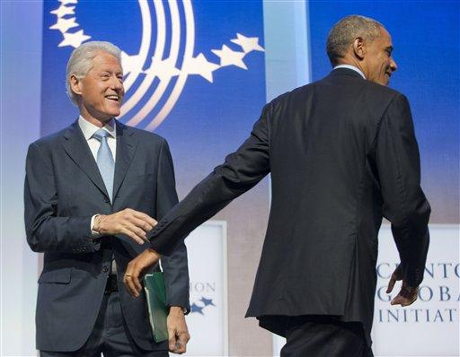 President Barack Obama is greeted by former President Bill Clinton at the Clinton Global Initiative in New York.