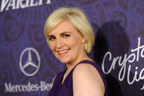 In this Aug. 23, 2014 file photo, actress Lena Dunham arrives at Variety and Women in Film's pre-Emmy celebration in West Hollywood, Calif.