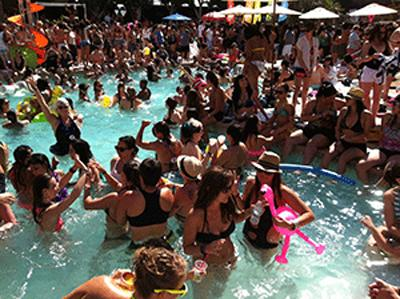 Guests hanging out in the pool at one of the famous pool parties at The Dinah 2013