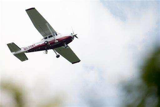 A small plane flies near Manassas Regional Airport in Manassas, Va.