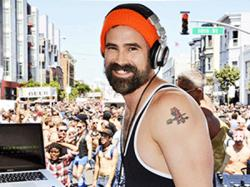 DJ Robbie Martin at the Up Your Alley Street Fair in 2012