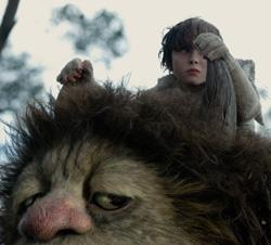 """Max (Max Records) hops a ride on Carol (voiced by James Galdofini) in """"Where the Wild Things Are"""""""