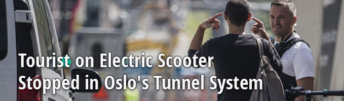 Tourist on Electric Scooter Stopped in Oslo's Tunnel System