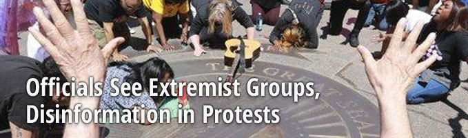 Officials See Extremist Groups, Disinformation in Protests