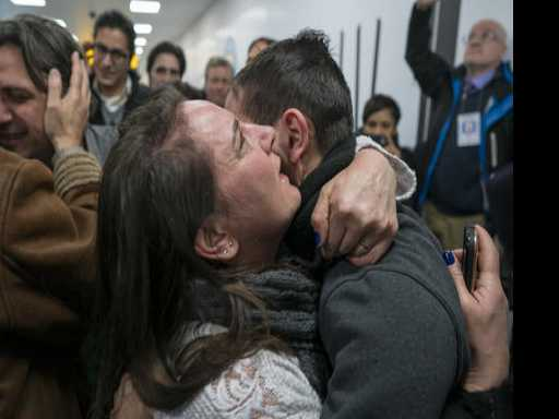 Appeals Court Weighs Ban as Travelers Arrive in Tears