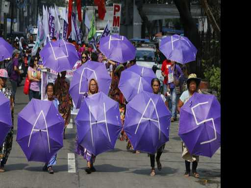 Puerto Rico Women Clad In Purple March at Dawn