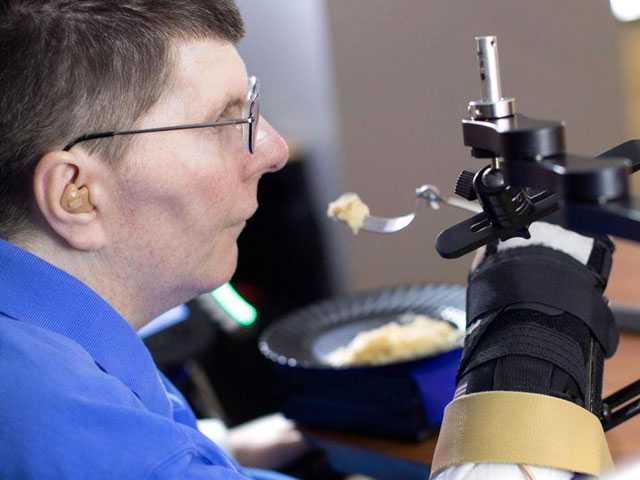 Brain and Arm Implants Help Paralyzed U.S. Man Feed Himself