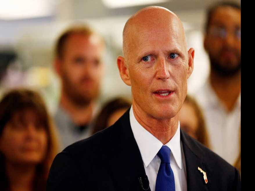 Florida Activist Confronts Gov. Scott Over Omissions