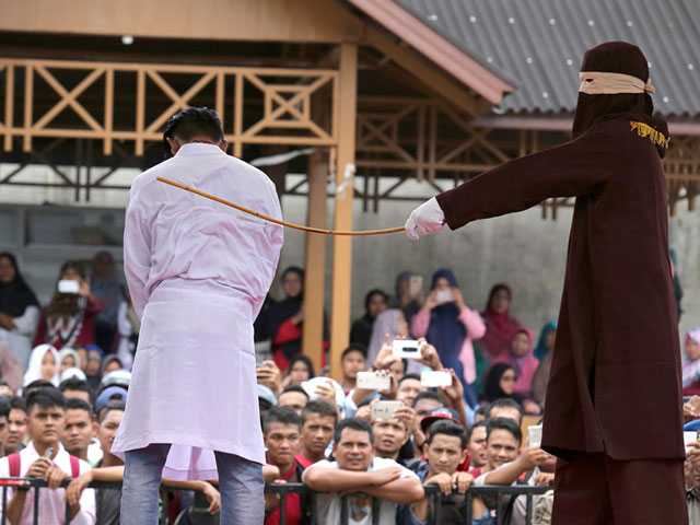 2 Men in Indonesia Caned Dozens of Times for Gay Sex
