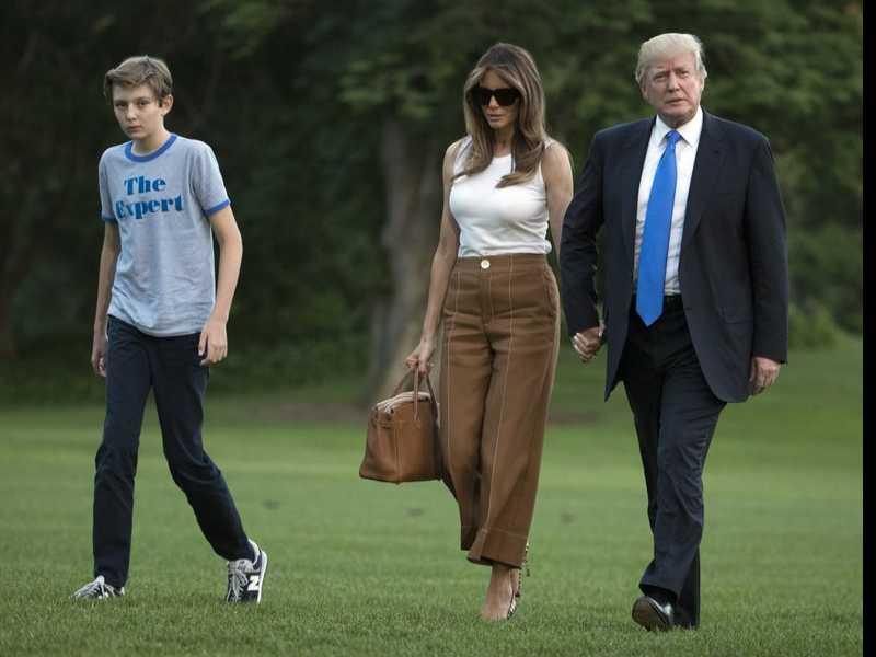 Melania Trump keeps DC entry low key; Barron draws interest