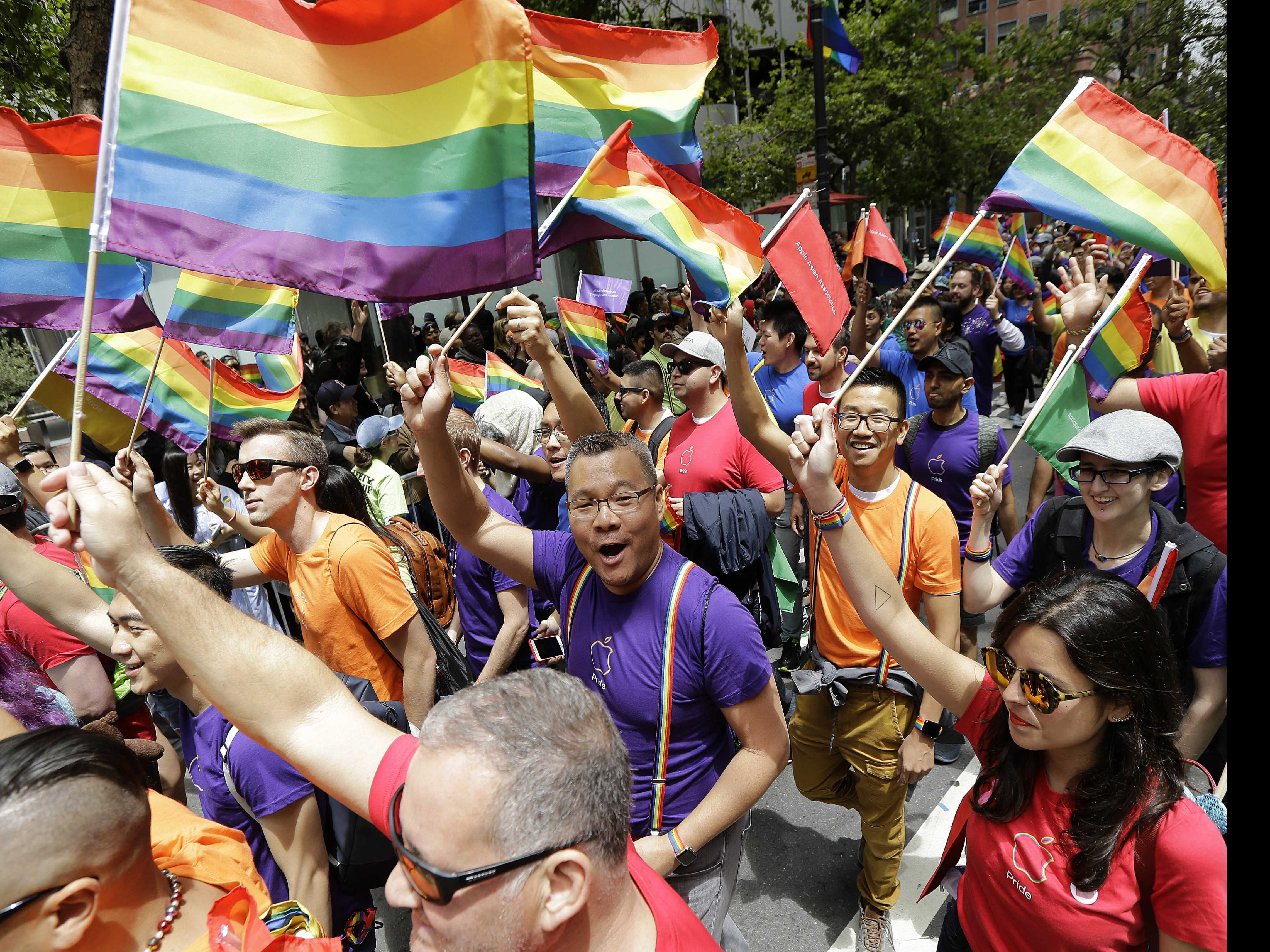Pride Parade Revelers Feel Need to Stand Up for Rights