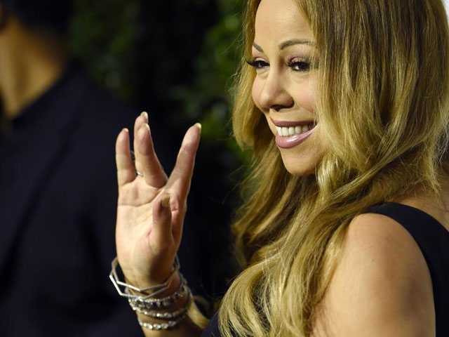 PopUps: Mariah Carrey Comments on International Scandal Involving Ex-Fiancé