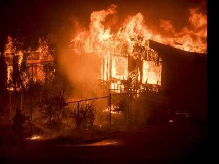 Thousands Flee Wildfires in California; Canada Blazes Grow