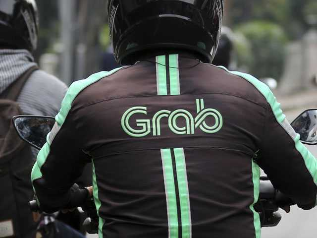Grab Builds War Chest In a Fight for Car-Share Dominance