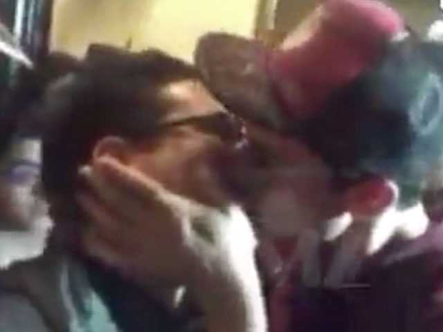 Watch: Actor Ezra Miller Kisses Fanboy at Comic-Con