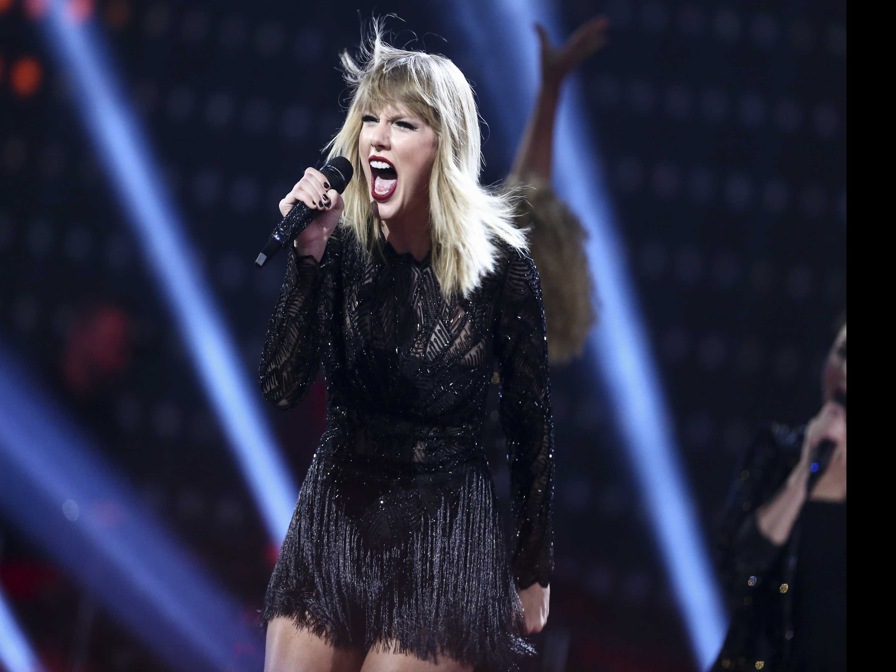 Watch: A Snake's Tail? A Solar Eclipse. Taylor Swift Teases Fans