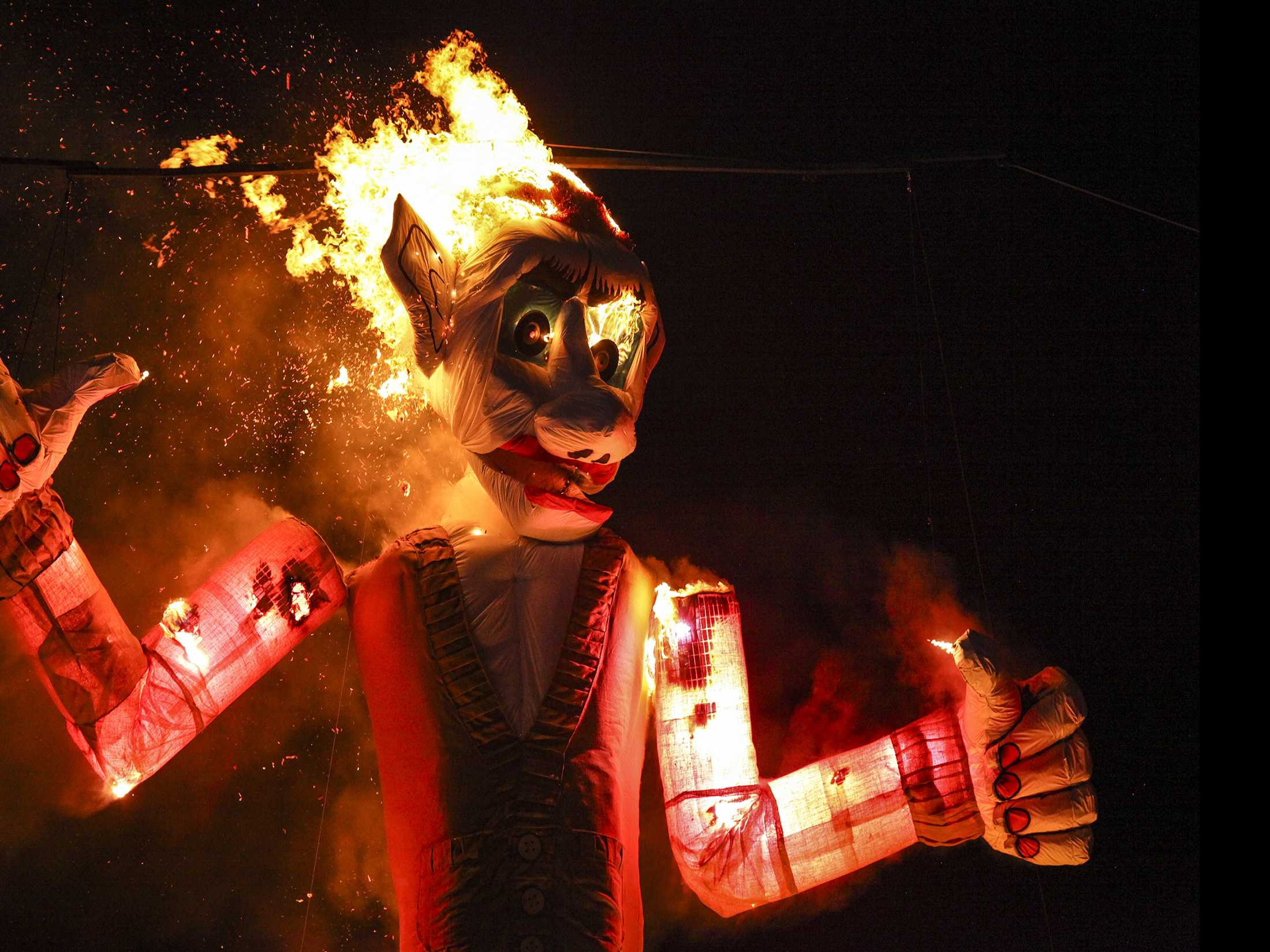 Flames Lick Up People's Fears in Ritual Effigy Burning