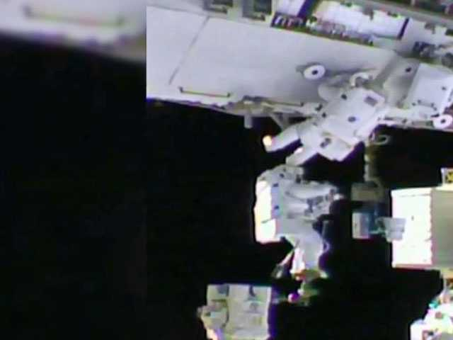 Astronauts Go Spacewalking to Grease Robot Arm's New Hand