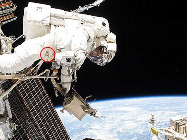 Spacewalking Astronauts Replacing Blurry Camera on Robot Arm