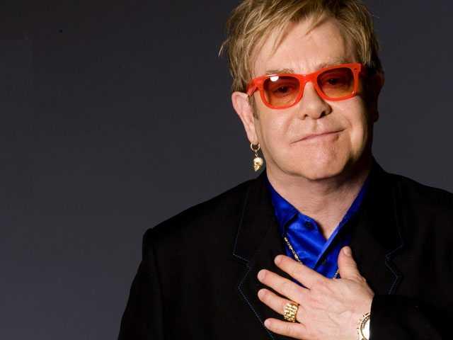 Harvard Honoring Elton John for Efforts to Fight HIV, AIDS