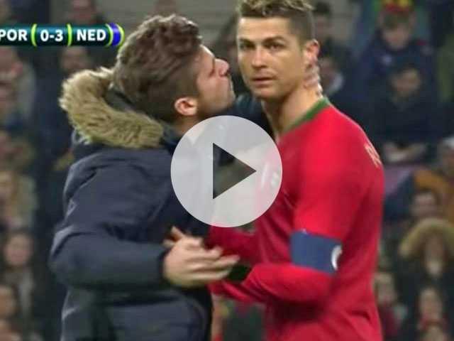 Watch: Male Football Fan Rushes Field to Kiss Cristiano Ronaldo