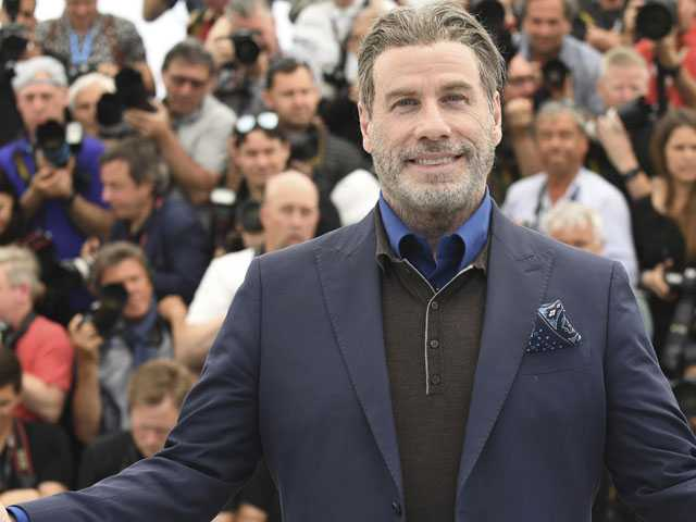 Travolta Dances His Way Through Cannes Again with 'Gotti'