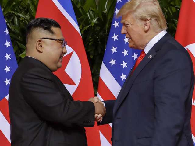 Trump-Kim Shake Hands, Commit to 'Complete Denuclearization'