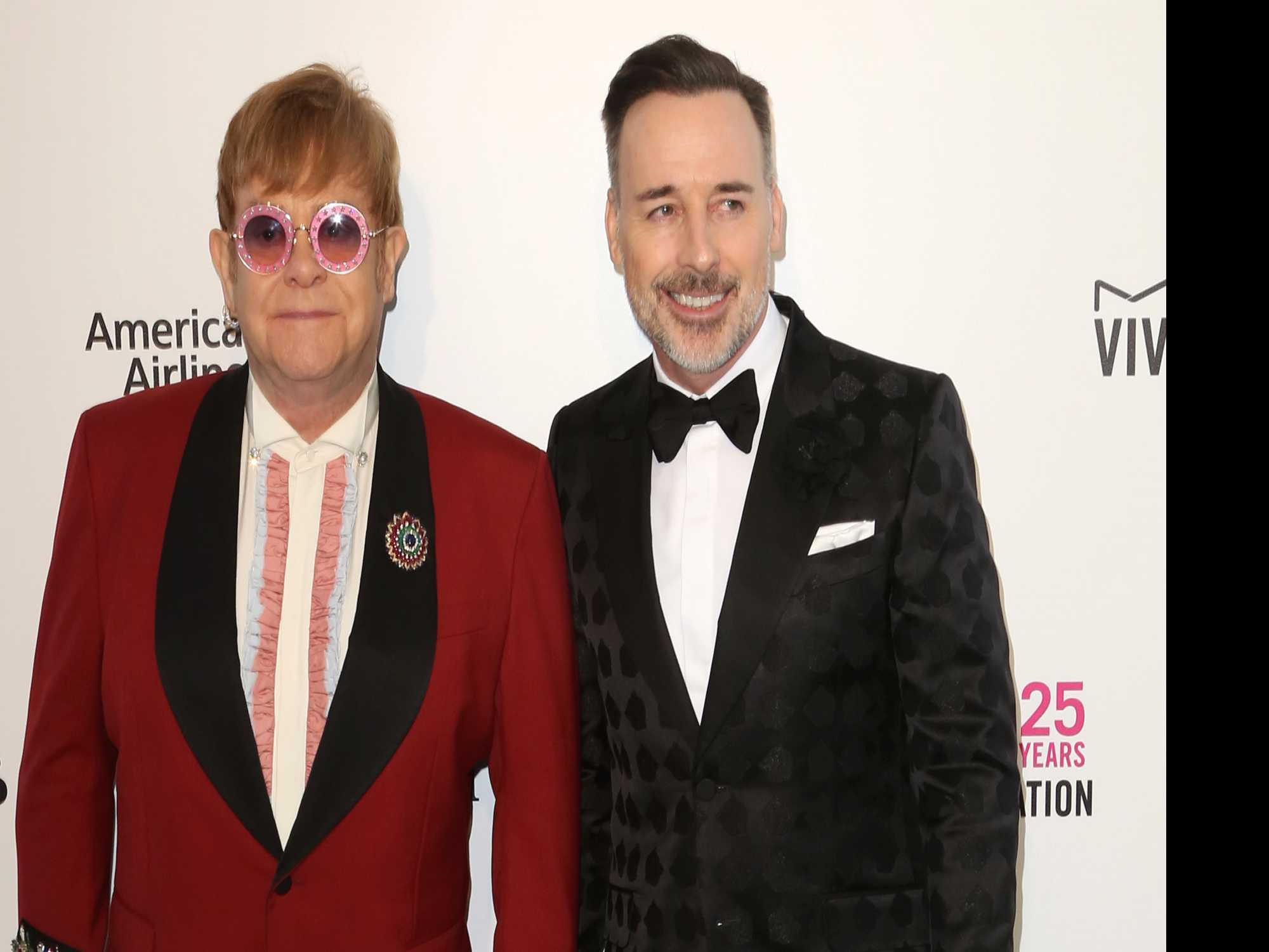 Singer Elton John and Partner Win Libel Judgment