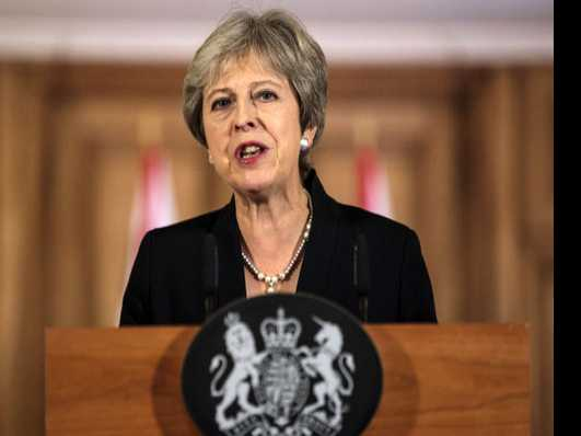 UK Leader May Hits Back on Brexit Plan; Pound Plunges