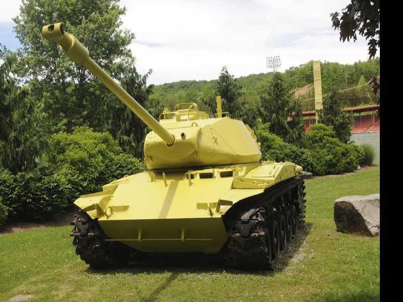 Ready, Aim, Oops! Historic Tank Turns Lemon-Lime Yellow