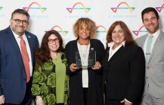 Lesbian travel leader honored by A Wider Bridge